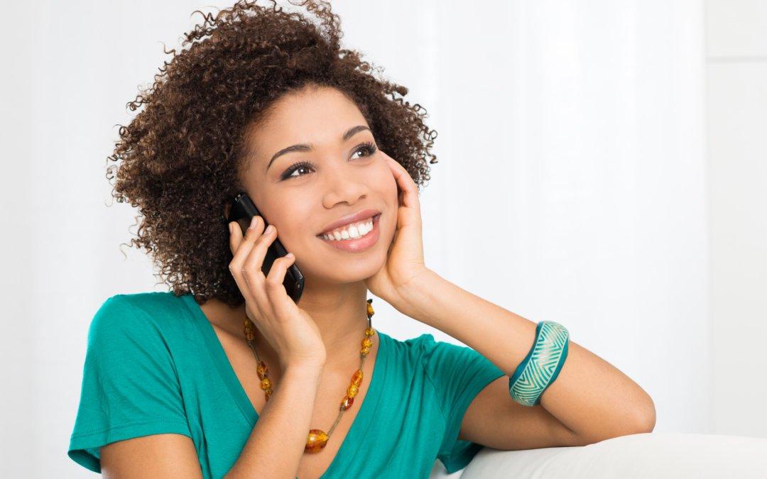 Happy Woman Talking On Cellphone